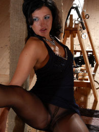 Sweltering brunette babe in luxury black pantyhose diddling her sweet hole pictures at freekilomovies.com