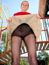 Frisky babe in barely black pantyhose doing some exercises at sports ground pictures at lingerie-mania.com