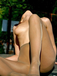 Outdoor pantyhose amusement of extremely seductive chick with killer body pictures at adipics.com