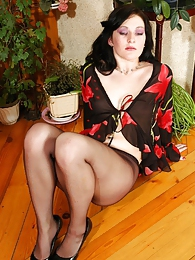 Attractive brunette babe in nylon pantyhose watering her beautiful flowers pictures at lingerie-mania.com