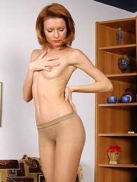 Red hot chick in nylon pantyhose brings herself pleasure while undressing pictures at lingerie-mania.com