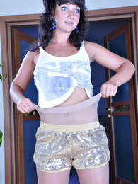 Jazzy brunette changing her shiny black sheer-to-waist hose for pale grey pictures