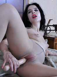 Vamp temptress rams her puffy pussy thru ripped open sheer grey pantyhose pictures at find-best-lingerie.com