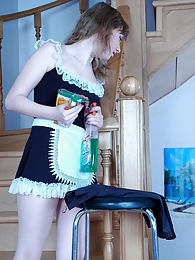 Curious maid in white tights trying on a sexy red blouse and a dark skirt pictures at kilogirls.com