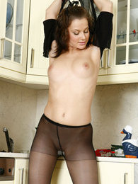 Downtrousers gal in black pantyhose pulls down her denim doing nasty things pictures