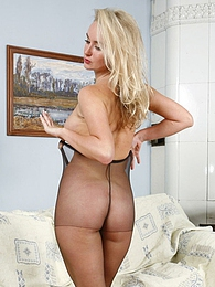 Mischievous blondie adores the feeling of sheer pantyhose on her long legs pictures