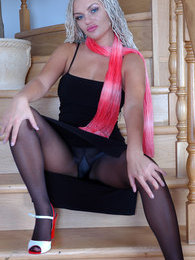 Bigtitted chick posing in her black lacy pantyhose to get some extra cash pictures at lingerie-mania.com