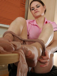 Stunningly beautiful sec changing her torn pantyhose for newly bought ones pictures