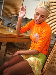 Freaky chick smoking a cig and demonstrating her tan control top pantyhose pictures at sgirls.net