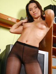 Spicy chick rubbing a wood pole against her pussy in her nylon black tights pictures at lingerie-mania.com