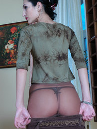 Nasty chick inspects her control top pantyhose before putting on her skirt pictures at find-best-panties.com