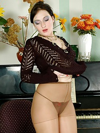 Lusty babe can play the piano and stroke her pantyhose clad pussy at once pictures at kilopics.com