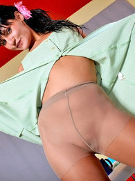 Pony-tailed babe fervently pampering her long legs in satin sheen pantyhose pictures