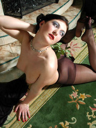 Cutie fondling her legs with beautiful rose without taking off her nylons pictures at lingerie-mania.com
