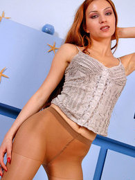 Awesome redhead gal in sheer pantyhose can turn on any guy just in a minute pictures