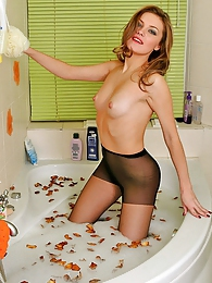 Playful chick preparing to take a steamy bath right in her black pantyhose pictures at lingerie-mania.com