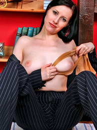 Lewd business lady rubbing her pantyhosed pussy with another pair of tights pictures