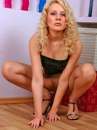 Curly blonde in smooth pantyhose warming up her delicious pink on the floor pictures at find-best-ass.com