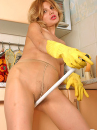 Pantyhosed chick polishing her pussy with playful hands in rubber gloves pictures