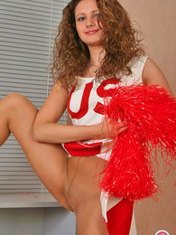 Skittish cheerleader in sexy pantyhose playing with ball right on the floor pictures at kilopics.com