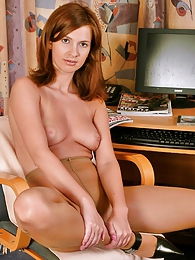 Awesome chick with well-shaped body slowly undressing up to silky pantyhose pictures at kilogirls.com