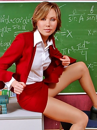 Luscious teacher in smooth pantyhose fondling her boobs in the classroom pics