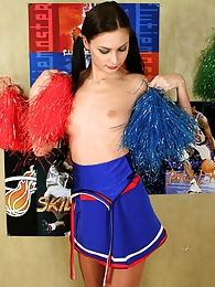 Freaky cheerleader pulling at her nylon pantyhose to show her pink close-up pictures at freekilomovies.com