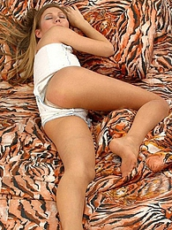 Sleepy chick in skimpy outfit and smooth pantyhose moving aside her panties pictures at lingerie-mania.com