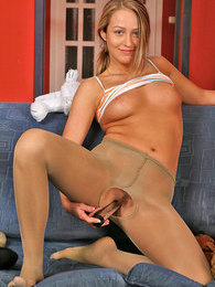 Dissolute chick in sheer pantyhose playing with her plush bear and sex toy pictures at find-best-lingerie.com