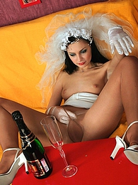Bride has a drink before stuffing bottle into her wet pink clad in nylons pictures at lingerie-mania.com