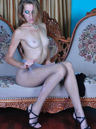 Leggy stunner puts on gorgeous patterned grey hose instead of laddered ones pictures at kilosex.com