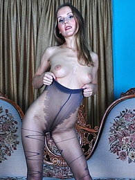 Flirty hottie seducing us with her smashing patterned V-line top pantyhose pictures at freekilosex.com