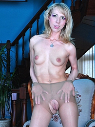 Dazzling blonde strips off and fingers in her suntan control top pantyhose pictures at freekilosex.com
