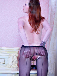 Fiery redhead fingers her unshaved pussy right thru black seamed pantyhose pictures at lingerie-mania.com