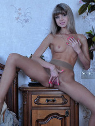 Frisky blondie has got pantyhose under her shorts ready for hot nylon tease pictures