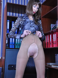 Leggy office babe hikes her skirt to toy her ass thru sheer crotchless hose pics