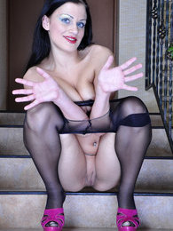 Sexy raven-head flashes on the stairs in her exclusive back seam pantyhose pictures at freekiloporn.com