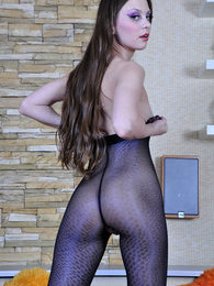 Hot girl dresses for a party admiring her glittery animal print pantyhose pictures at lingerie-mania.com