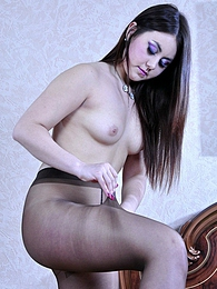 Nylon loving babe tries to choose the best fitting pair of hose for tonight pictures at adipics.com