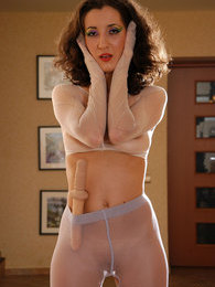 Horny pantyhose junkie enjoys dildo toying while in full nylon encasement pictures at adspics.com