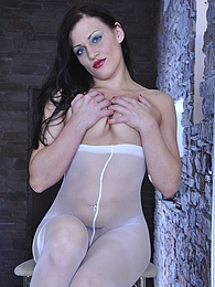 Sultry brunette reveals her great flexibility while trying on her pantyhose pictures