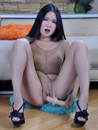 Exotic hottie wears full pantyhose encasement ready to use her long dildo pictures at sgirls.net
