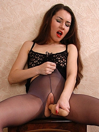 Dark-haired babe gives in to her lust dildo toying in control top pantyhose pictures