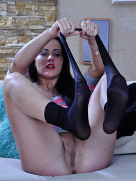 Nylon loving brunette plays with her classy black and shiny nude pantyhose pictures at find-best-panties.com