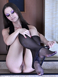 Frisky cutie fools with her black sheer-to-waist pantyhose on the stairs pictures