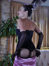Fancily dressed show-girl strips to her sheer-to-waist pantyhose and gloves pictures at lingerie-mania.com