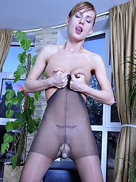 Sassy girl strips her jeans and slips a dildo under control top pantyhose pictures at freekiloclips.com