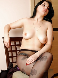 Curvaceous gal rolls down her stylish dark pantyhose with a glittery design pictures at kilogirls.com