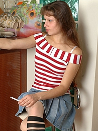Sexy smoker in matching her outfit stripy tights stuffing a red jelly toy pictures at very-sexy.com