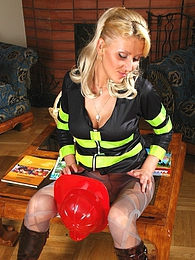 Sexy fire-fighter strips uniform to show her love to colored chic hosiery pictures